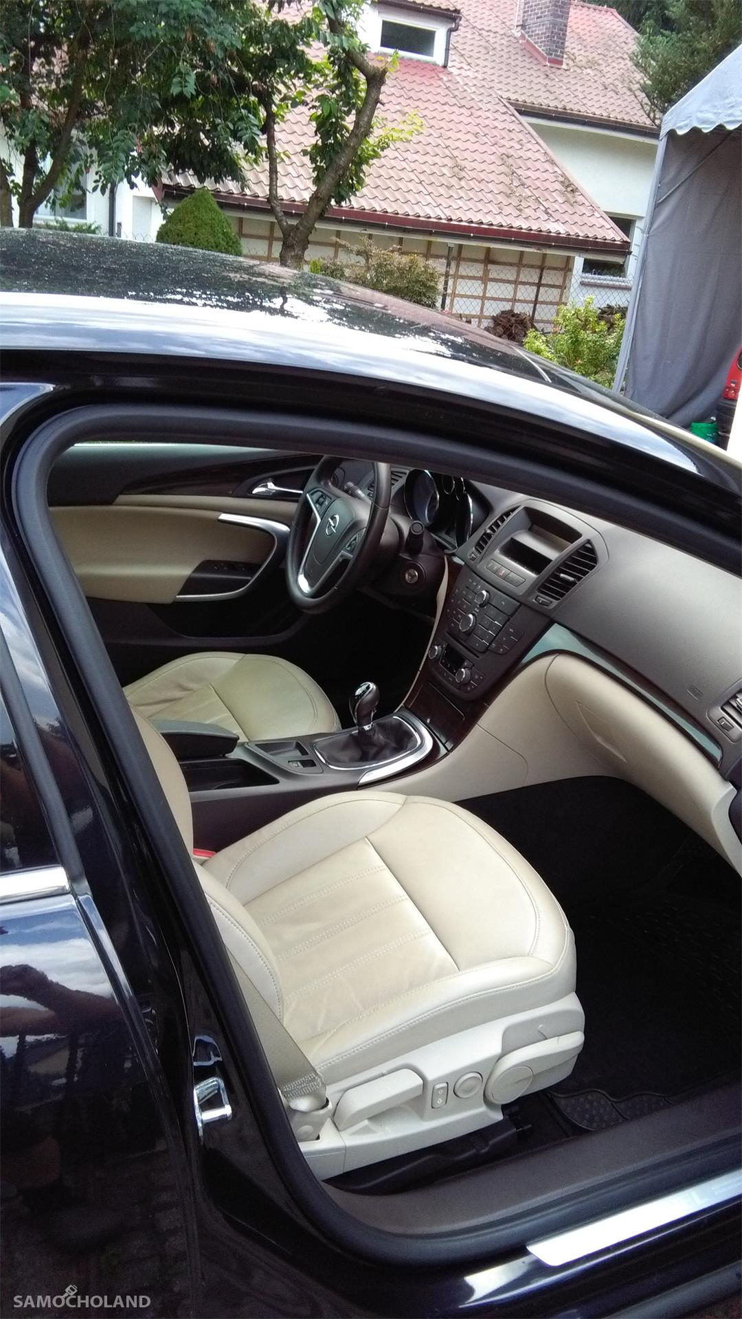 Opel Insignia Auto kupione w Polskim salonie Opla.Pierwszy właściciel, od początku garażowany.Stan techniczny oraz wnętrza bardzo dobry. Niwielki przebieg - 83400 km. 16